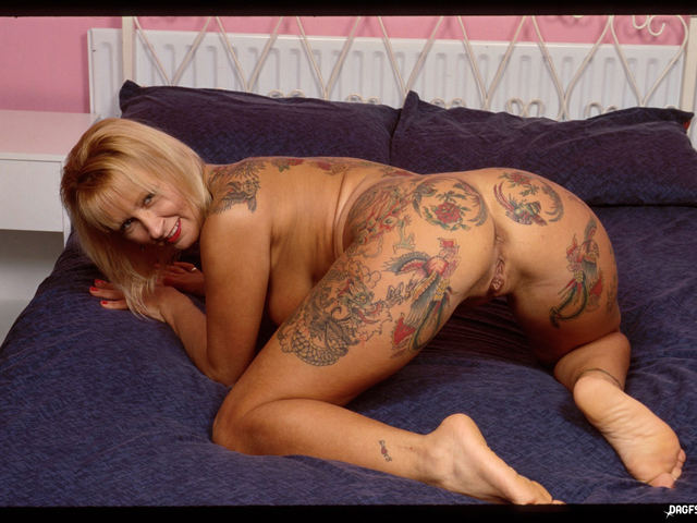 tammy is an old school tattooed rocker chick who just loves sex and showing her pussy